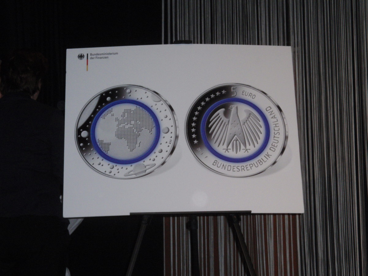 A closer view of the new German Planet Earth 5-euro coin with the polymer ring colored blue.