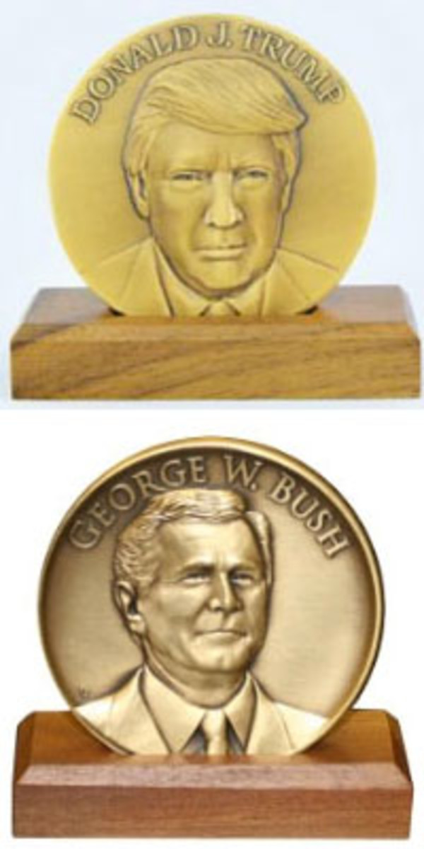 Although the new Trump medal (top) looks like an inaugural medal, especially on the obverse side, it does not say it is an inaugural medal. Shown for comparison (bottom) is an official George W. Bush inaugural medal.