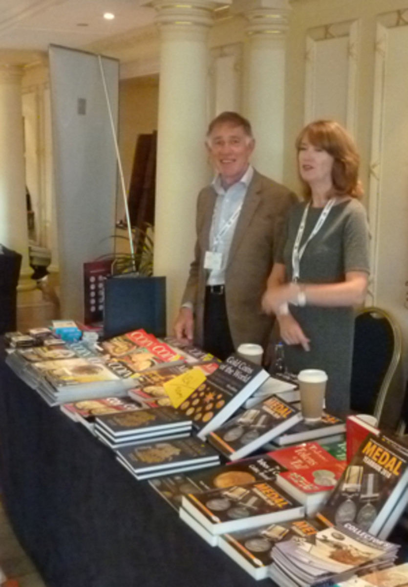 John Mussell helps staff his table at the Coinex show.