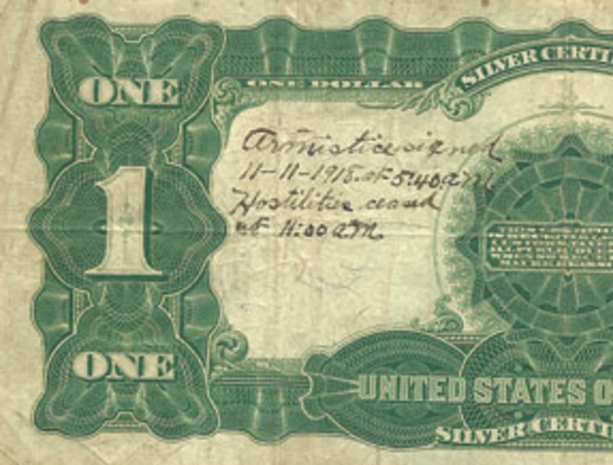 An unknown American soldier recorded the end of World War I on the back of this Series of 1899 Black Eagle $1.