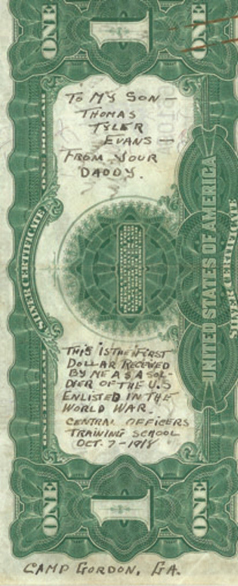 The back of Lt. Evans first dollar of pay shows his inscription to his son, detailing his time at Camp Gordon in Georgia.