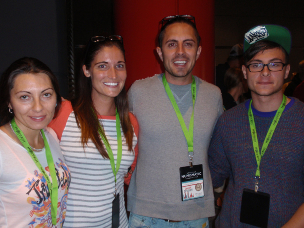 (L to R): Rina Maya, Callie Hohlfeld, and Nick and Daniel Yadgarov, all of Los Angeles, were the first four people in line to buy the gold Kennedy half dollar.