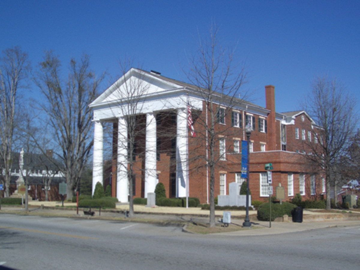 The Greene County Courthouse, built in the Greek Revival style of the time, dominates the center of Greensboro, Georgia.