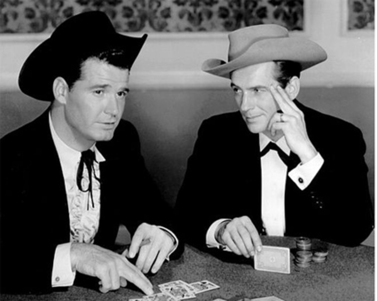 James Garner as Bret Maverick (left) and Jack Kelly (right) as his brother Bart. (Image by Warner Brothers Television (eBay item photo front photo back) [Public domain], via Wikimedia Commons)