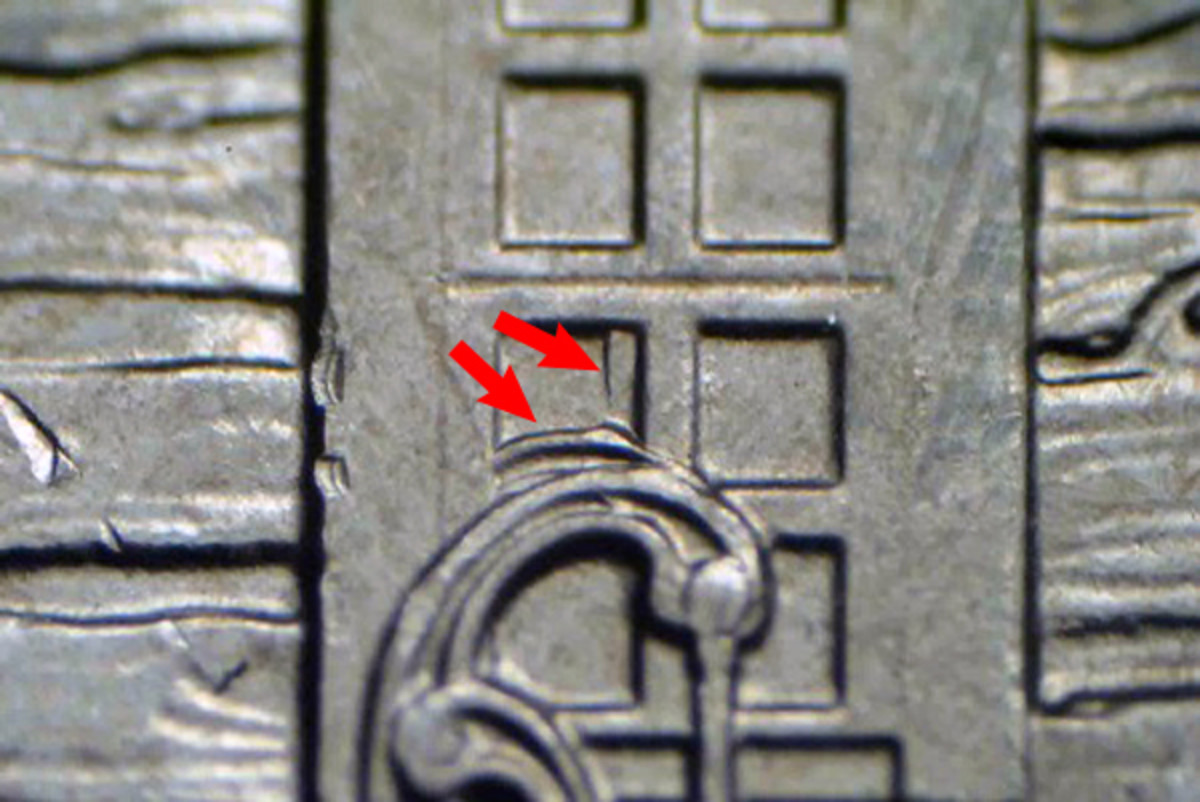 A more minor doubled die on the Homestead quarter is in the window pane to the left of the major doubled die.