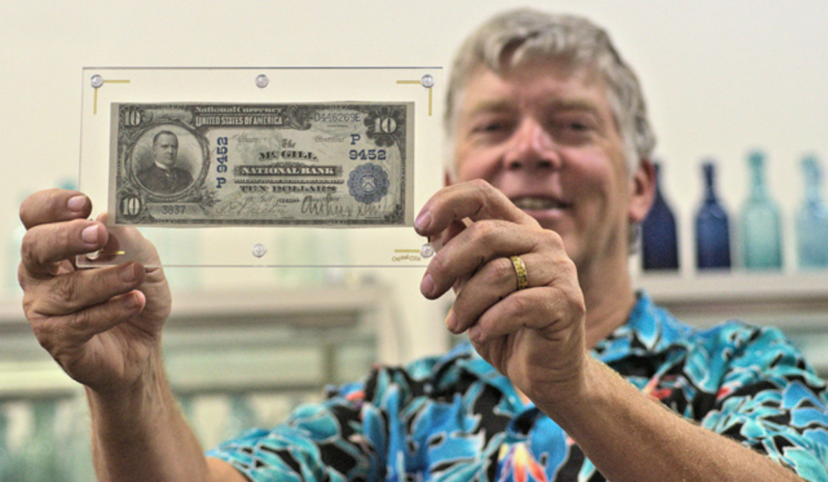 Fred Holabird holds a rare McGill National Bank note.