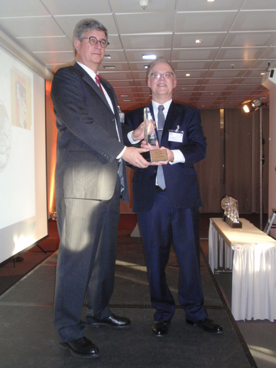 Gerhard Starsich, principal director of the Austrian Mint, accepts one of three COTY awards for Austrian coinage.