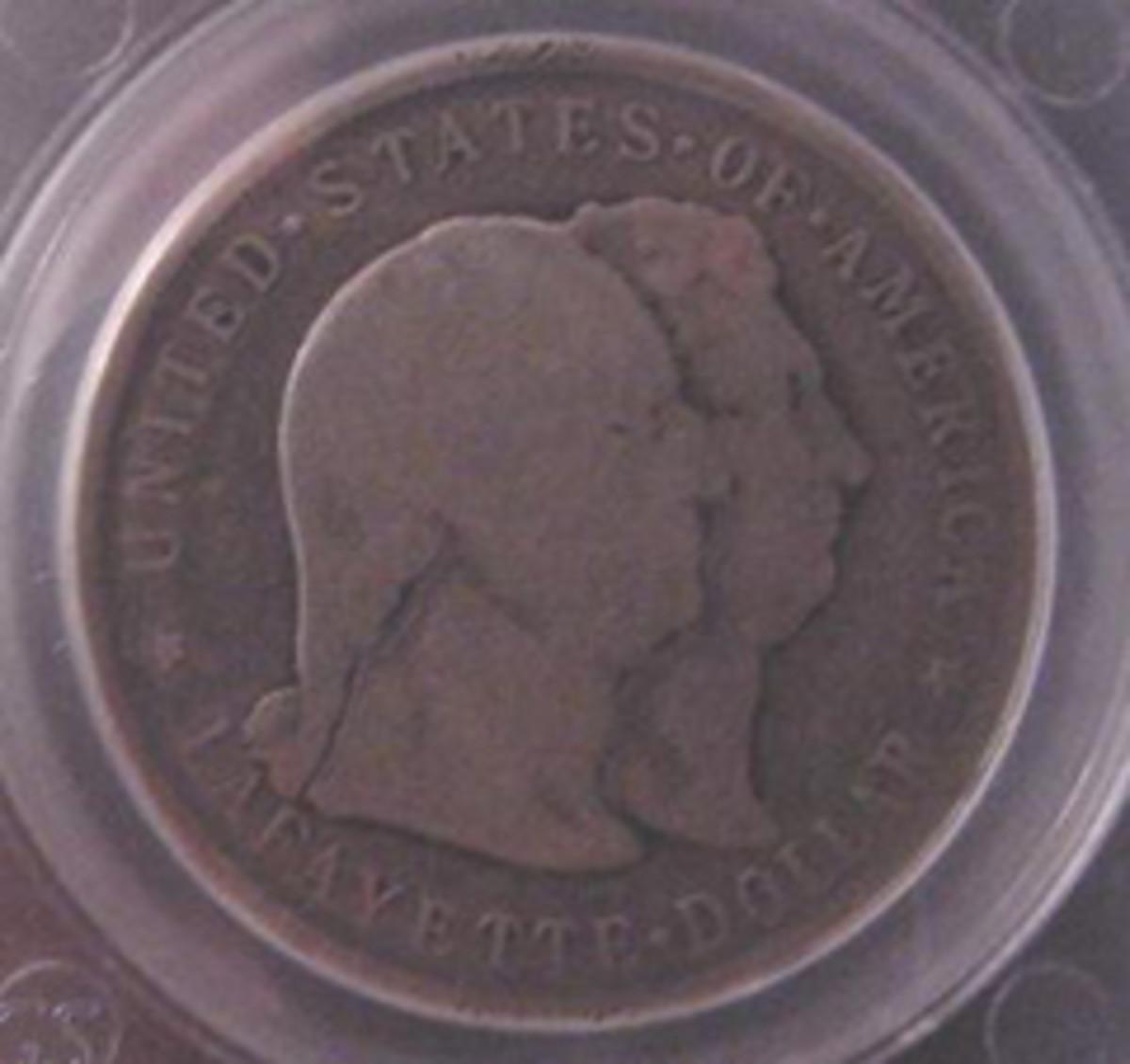 NN11 is a Lafayette dollar worn to very good.