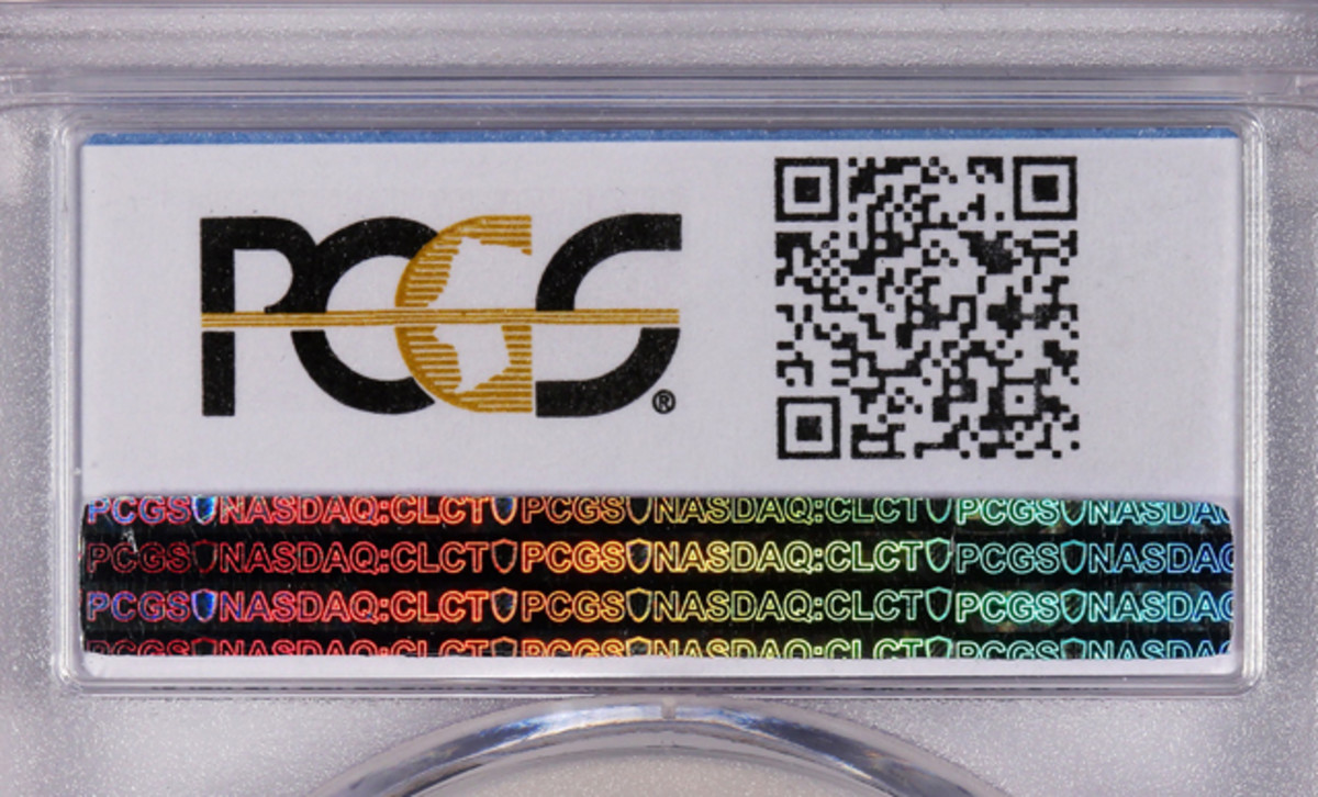 A QR Code links the holdered coin to a verification page.