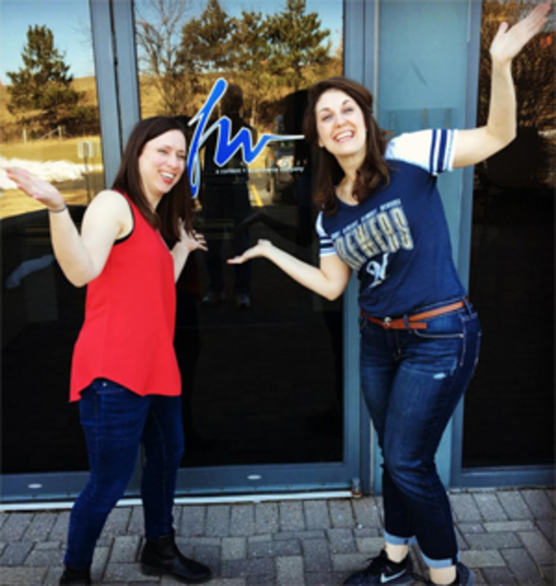 Saying hello from the new front entrance of F+W Media are current and former 'Numismatic News' graphic designers Rebecca Vogel (left) and Nicole MacMartin (right).