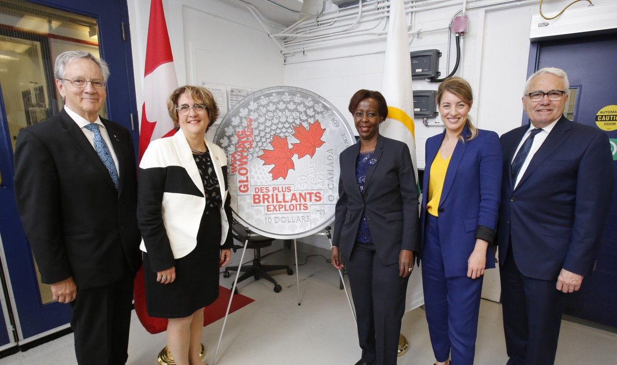 From left: Gilles Patry of the Royal Canadian Mint Board of Directors, Mint President and CEO Marie Lemay, the Secretary-General of La Francophonie Louise Mushikiwabo, the Minister of Tourism, Official Languages and La Francophonie Mélanie Joly and Official Languages Commissioner Raymond Théberge celebrate the striking of a new collector coin recognizing the 50th anniversary of the Official Languages Act at the Mint's Ottawa (Photo courtesy of the Royal Canadian Mint)