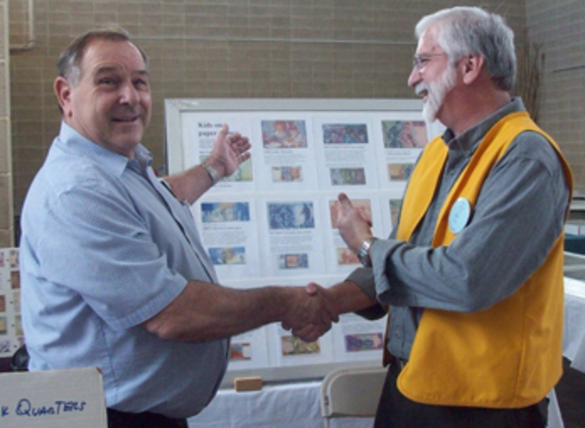 American Numismatic Association Past President Walt Ostromecki and ACC President Bill DeWeese at the dedication and opening ceremony of the 2017 ACC fall show Kid's Zone activity and education area.