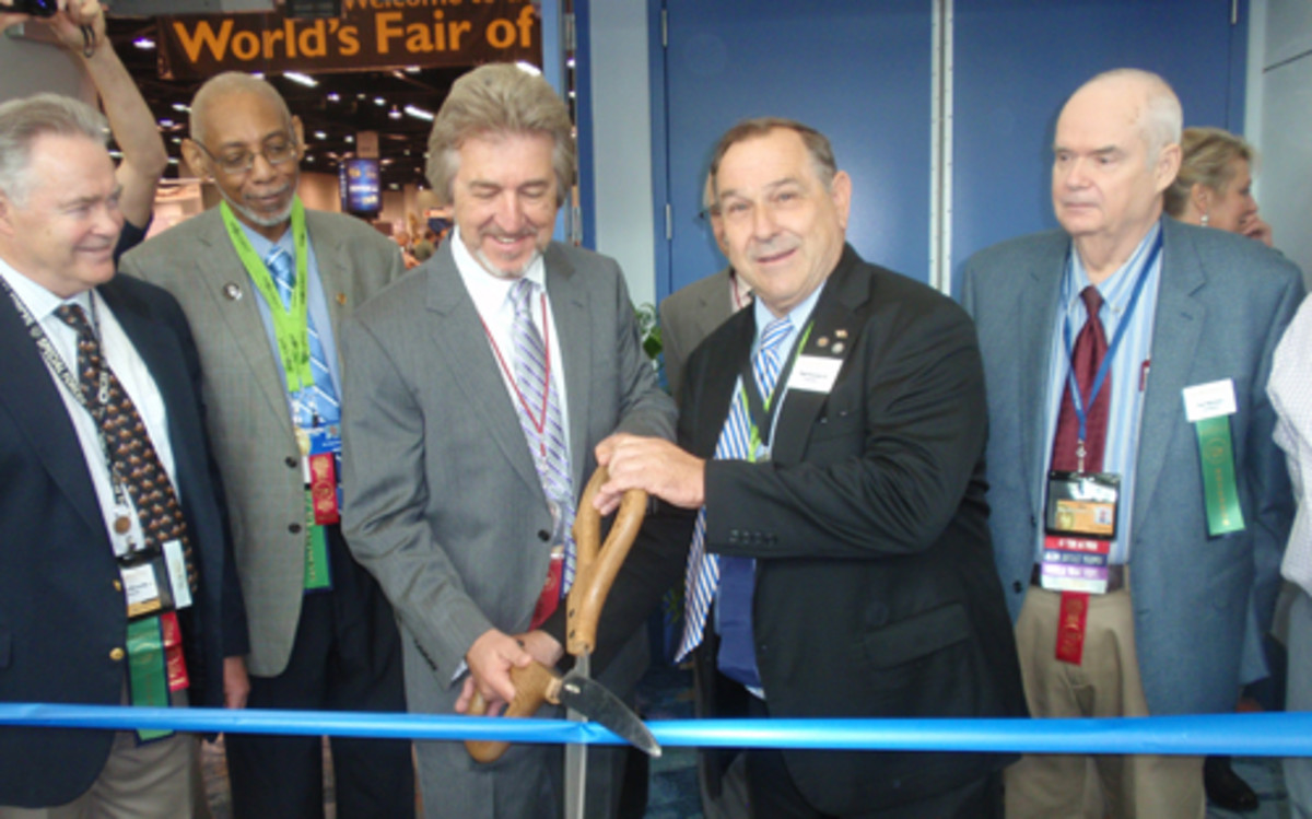 The ribbon was cut to open the ANA bourse floor by, left to right, Col. Steve Ellsworth, Ralph Ross, President Jeff Garrett, Walt Ostromecki and Tom Mulvaney.