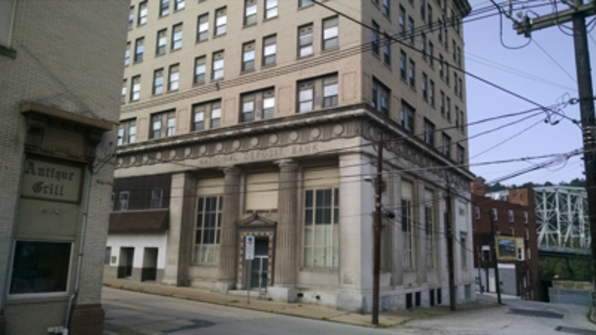 The multi-story National Deposit Bank of Brownsville sits abandoned across from the equally derelict Antique Grill on Market Street.