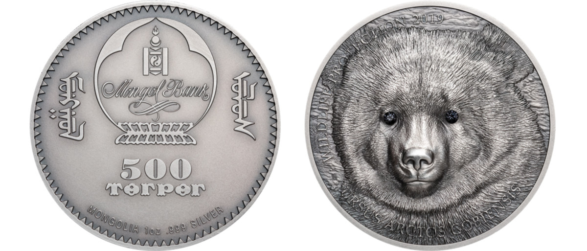 Mongolia's Wildlife Protection series began in 2007 with the Gulo Gulo, which won the Best Silver Coin award and took the overall COTY honors that year. The bold, front -facing design and use of crystals for the eyes were in use for this series right up to the end. Often imitated, the high relief and crystals were modified throughout the series' life as technologies advanced. The last coin in the series features the Gobi Bear. It has been nominated in the Best Crown category as a fitting bookend to a stellar run.