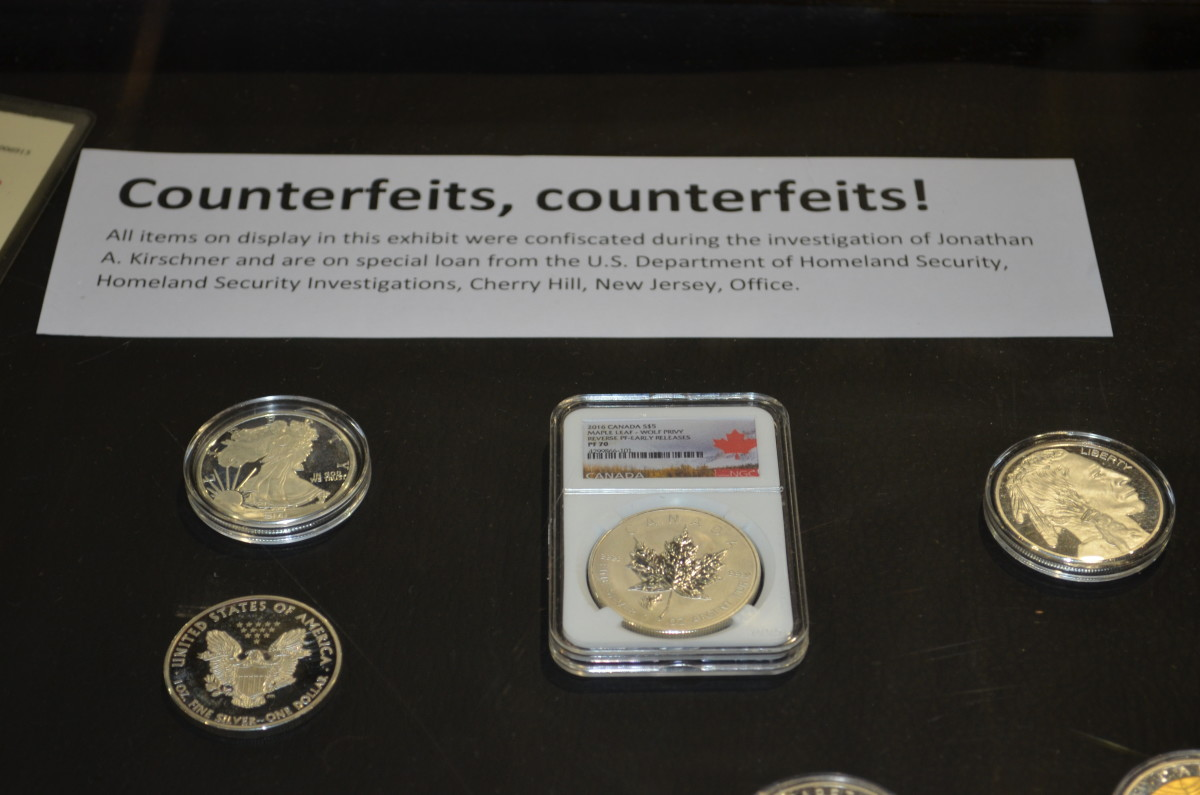 A display shows examples of counterfeit bullion coins that were confiscated during the U.S. Department of Homeland Security investigation of Jonathan A. Kirschner.