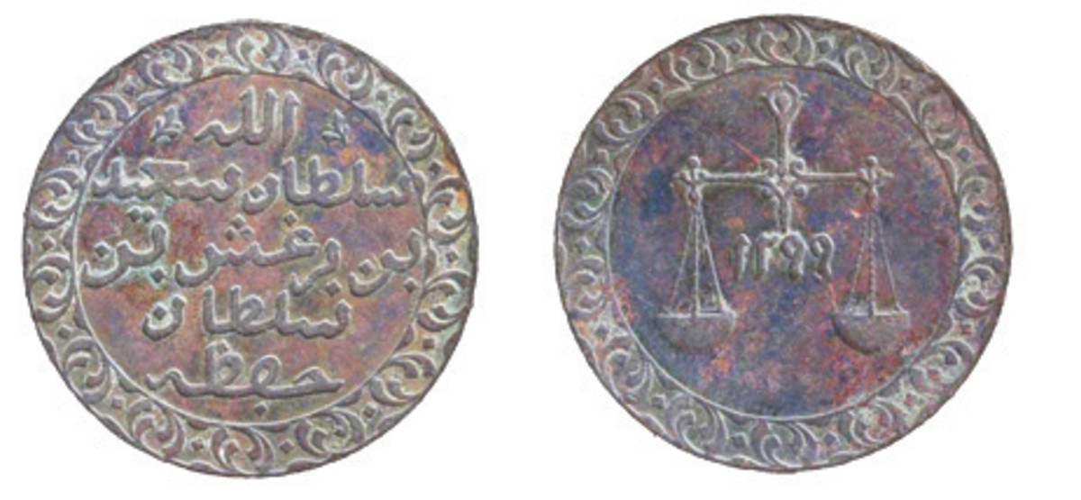 The Zanzibar paisa of 1883 was made to equal the British Indian quarter anna and was struck in Belgium. The scales motif came from the old BEIC Bombay coinage. (Actual diameter 25mm).