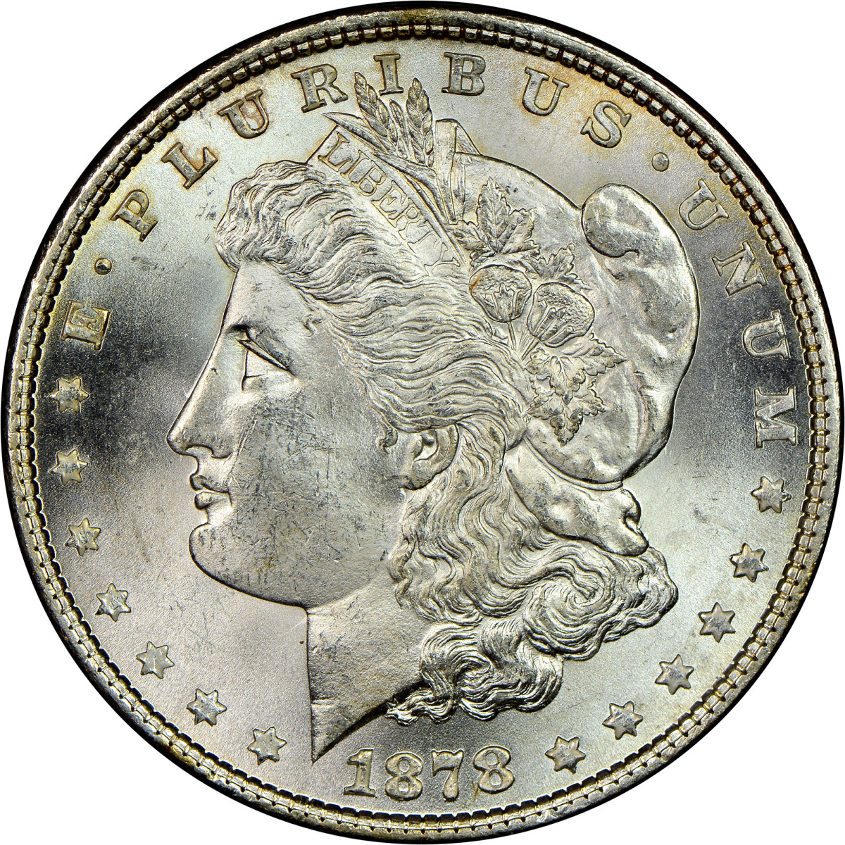 Popular with collectors and investors, genuine Morgan silver dollars, such as this one, were produced by the United States Mint between 1878 and 1921 – but beware of counterfeits in the marketplace. (Photo courtesy of Numismatic Guaranty Corporation.)