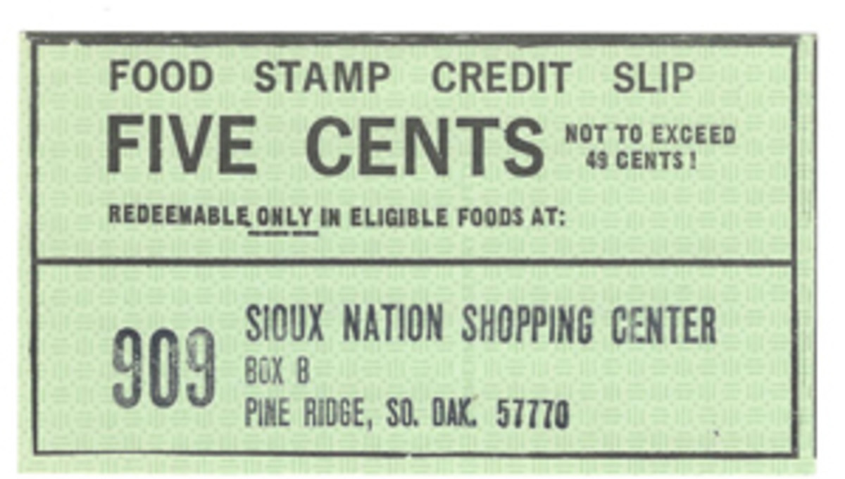 The Sioux Nation Shopping Center is based in Pine Ridge, SD; this style of scrip with stamped store name was issued in the 1972-75 years. A piece such as this provides a wide-open door to the often sad story of how Native Americans have been treated through the years.