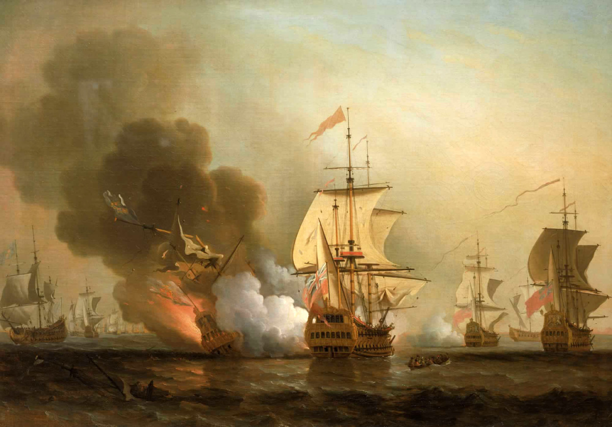 A painting by Samuel Scott (1702-1772) depicts the destruction in 1708 of the treasure galleon San José off the coast of Cartagena, Colombia. Prospects for recovery of the vessel and establishment of a museum to house and display its artifacts is to be one of the topics under discussion at Cartagena MMXXI – the 3rd International Convention of Historians and Numismatists. (Credit: Wikimedia Commons)