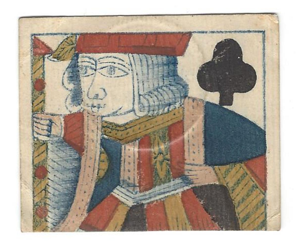 Cut piece from a jack of clubs as used for this 20 stivers. No identifying marks were placed on this side. The same individual who signed this piece also did the same for the 10-stiver and 1-gulden from this same printing. The 20-stiver shown here is not listed in the book; this may be the first time such a denomination is included for this issue.