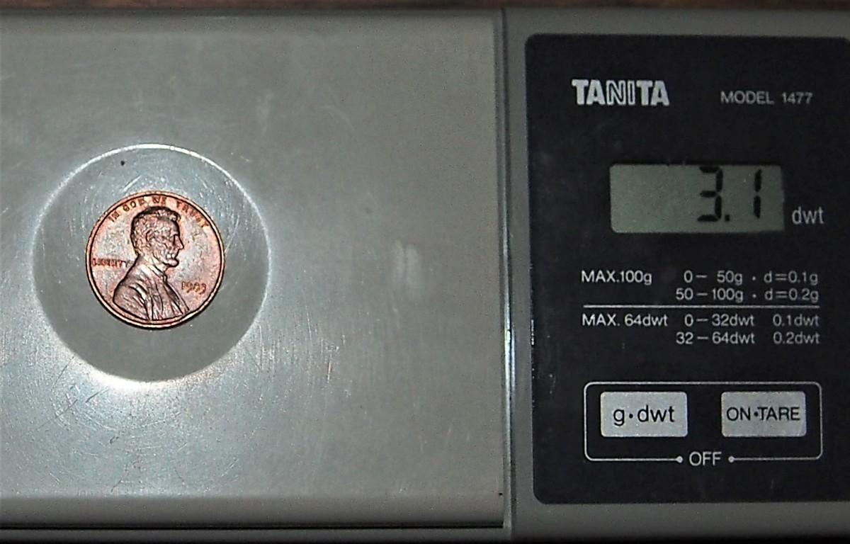 1983 1c on Bronze Planchet Obverse on scale Ernie Gesner specimen 31.1 grams Found it In Strk It Rich