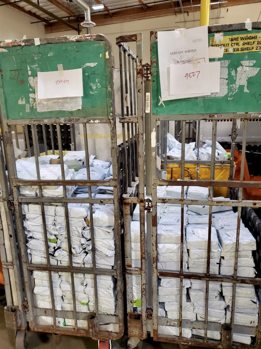 Some of the approximately 1,700 packages of seized counterfeit coin shipments that were at the International Mail Facility in Torrance, Calif.