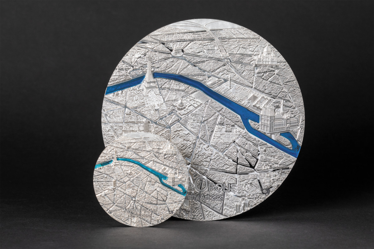 The large and the small of the new Tiffany art series featuring famous urban landscapes. The first coins in the series present Paris and the Seine.