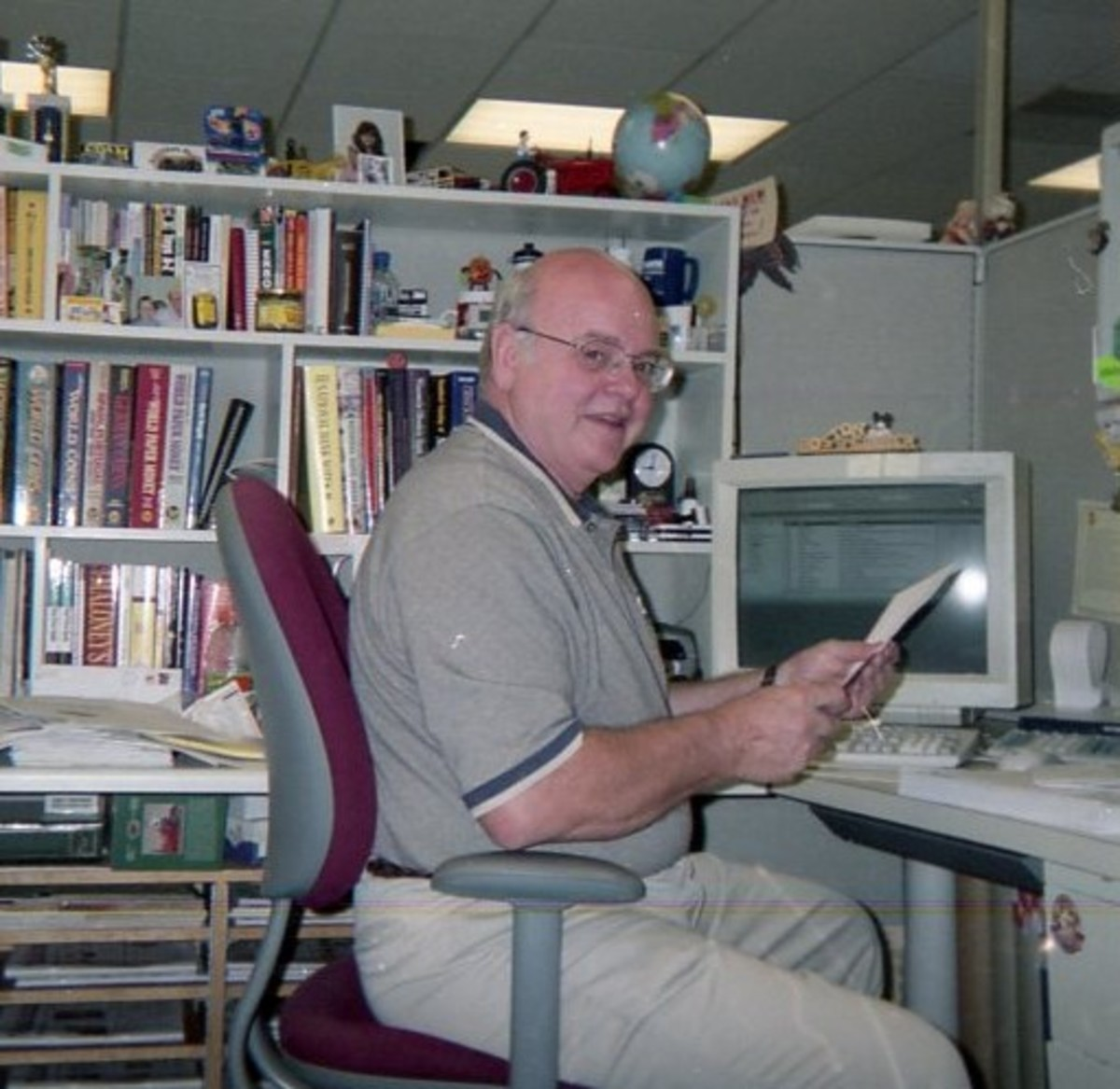 Joel Edler at his desk at Krause Publications, where he worked for 22 years. (Photo courtesy George Cuhaj.