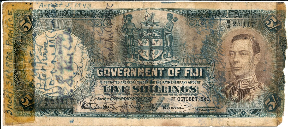 Typical somewhat worn and battered WWII short snorter on a Fijian 5 shillings note (P-37). Towards the top of the signatures on the face is that of Peter Kova, a musician who was part of the first USO party to tour the Pacific theatre. The 12-man group undertook 500 performances during a 12 months tour commencing in December 1942. They travelled 25,000 miles to New Guinea, Guadalcanal, Australia, New Zealand, New Caledonia, New Hebrides and Fiji often giving performances less than a mile from the front line. Image © Ω Collection 2021.